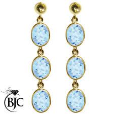 Pendientes de joyería con gemas naturales topacio