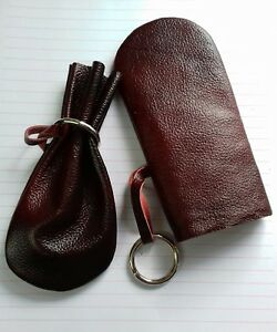 Real Burgundy leather coin pouch with metal ring to close top.