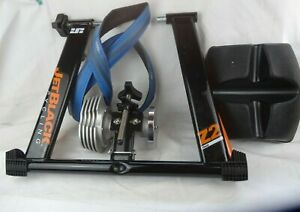 JetBlack Cycling Z2 Fluid indoor turbo trainer and wheel riser and indoor tyre
