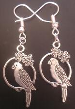 Handmade silver tone parrot earrings