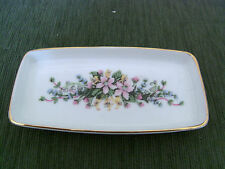 OBLONG PIN TRAY FROM ROYAL VALE POTTERY . GILT RIM, FLOWER SPRAY. 13 CM WIDE VGC