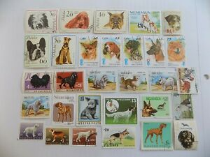 World Wide Topical Coll'n of used DOG stamps off paper -9-14-H-We combine ship