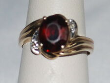 10k Gold ring with A Garnet gemstone and diamonds