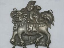 INTERESTING OLD WHITE METAL FIGURE RIDING MYTHICAL BEAST WITH DANGLING BELLS