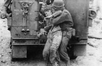 WW2 Picture Photo France 1944 US Soldier picks up a wounded German soldier 3290
