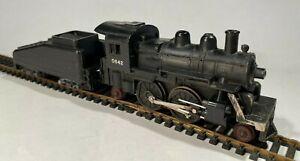 Lionel HO 2-4-2 Steam Locomotive & Slope Back Tender 0642LT