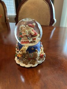 Santa And Mrs. Claus Musical Snow Globe