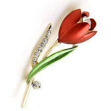 Broche en alliage de zinc émaillé et zircones, rouge, motif tulipe, neuve