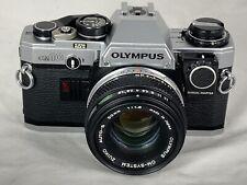 Olympus OM10 Film Camera & 50mm F1.8 Lens, New Seals, Man.Adapter, Excellent