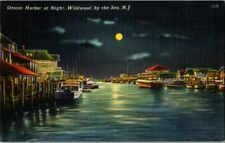 Postcard~Wildwood New Jersey~Ottens Harbor at Night~Vintage Boats~Posted 1959