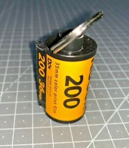 A Kodak Keyring made from an empty Film Spool for Kodak 35mm 200asa colour film