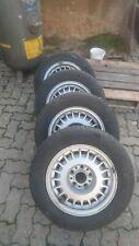 4x BMW 7x15 Zoll  E20 KBA 1129030 Alufelgen mit 205/65 R15 Winterreifen