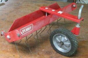 Toro 21-in. de-thatcher, front mount for walk-behind mowers