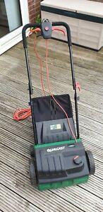 Lawn scarifier rake aerator