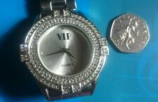 large faced ladies watch with jewel encrusted face stainless steel strap