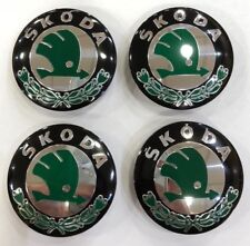 4x SKODA WHEEL CENTRE CAPS 56MM BLACK & GREEN HUB EMBLEM- FABIA OCTAVIA YETI VRS