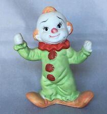 Ceramic Clown Figurine Green Costume with Red Ruffled Collar.