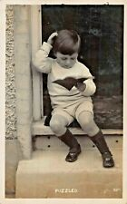 PUZZLED~YOUNG BOY READING-BRITISH PHOTO 1914 POSTCARD