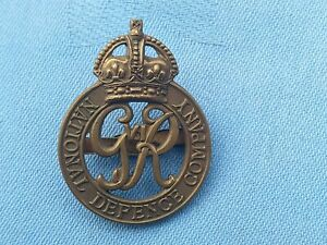 The National Defence Company Officers cap badge..
