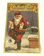 Vintage Embossed Christmas Postcard Santa With Presents Headed From Chimney