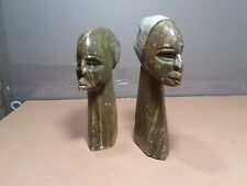 Vintage carved and polished African stone busts of a male, female sculptures