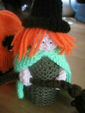 HAND KNITTED SPOOKY HALLOWEEN WITCH WITH HER BROOM. 6 INCHES TALL.