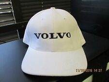 "VOLVO-WHITE CAP-""VOLVO"" IN BLACK ON THE FRONT-METAL BUCKLE W/ TUCK IN STRAP-BLEM"