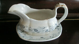 ANTIQUE GRAVY JUG WITH STAND