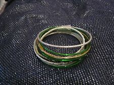 Many and Various bangle style bracelets in different designs & sizes