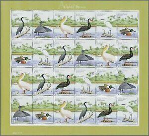 SMT, Guinea-Bissau: BIRDS, lot of 40 sets, in 10 sheets of 4, MNH