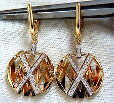 Cosmopolitan Mod X Diamond dangle earrings 14kt.