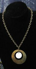 Nice bronze tone metal necklace with large circular pendant with white insert