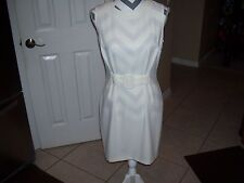 Vintage ladies dress by Marnie West in a size 6, off white, in great shape.