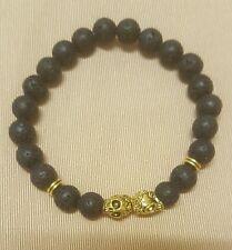 black lava stone and gold skull detail stretch bracelet
