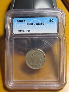 1867 with Rays Shield Nickel. ICG AU 50 RPD.