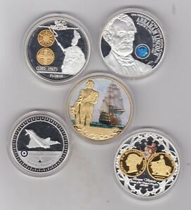 FIVE VARIOUS GOLD & SILVER PLATED MEDALS WITH CAPSULES IN NEAR MINT CONDITION.