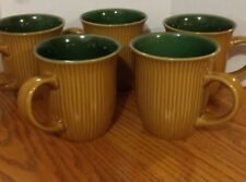 Coffee Mugs tan stripped with green inside