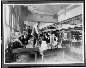 Postal workers sorting mail,tables,United States Post Office,Washington DC 1836