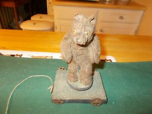 MADE IN GERMANY SPINNING BEAR PULL TOY ALL ORIGINAL HAS MUZZLE ON IT'S FACE CUTE