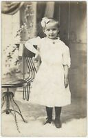 1900s Girl with Odd & Unusual Metal Chair Real Photo Postcard