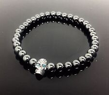 Hematite Stretch Bracelet With Blue Diamond Skull Charm By Sacred Angels