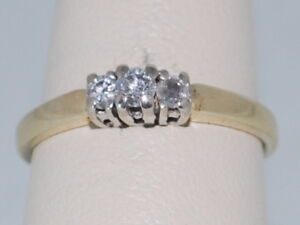 14k Yellow Gold Ring with a Trinity of Diamonds Set in a White Gold Setting