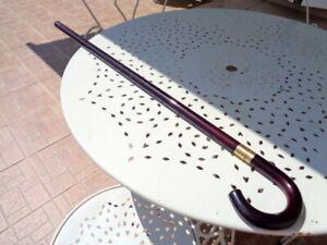 Ancienne canne a système épée en bakélite ou composite laqué