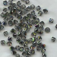 T4 5301 TK *** 30 toupies cristal Swarovski 4mm  TOPAZ AB2X