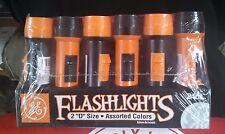 "Wholesale/Fleamarket Lot of 120 GE ""D"" Size Batt. Flashlights.Black and Orange."