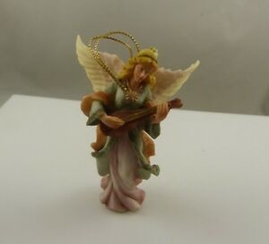 Angel holding a musical inst? plastic or resin  vintage  Christmas ornament xmas