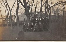18 Men in hats amongst trees ~1910 - REAL PHOTO Postcard