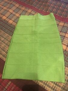 EUC Bebe Curve Contouring Bandage Bodycon lime green Mini Skirt Sz S
