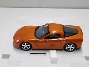 2007 CORVETTE COUPE  PROMO MODEL IN ORANGE   1.24 NEW IN THE BOX