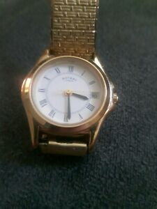 VINTAGE ROTARY LADIES QUARTZ WATCH GOLD PLATED 10524 IN GOOD WORKING CONDITION .